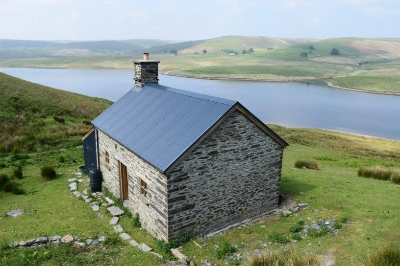 lluest Cwm Bach mountain bothy and Craig Goch lake beyond