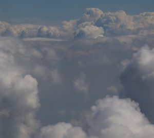 Cumulus clouds and atmosphere boundary layer seen from the plane