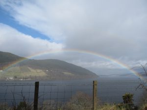 Loch Ness with rainbow near Uruquart Castle